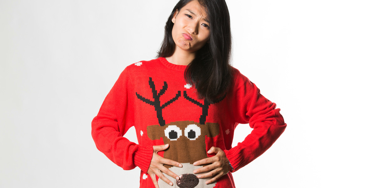 overeating woman in Christmas jumper