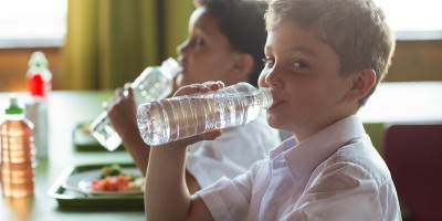 schoolboys drinking bottled water