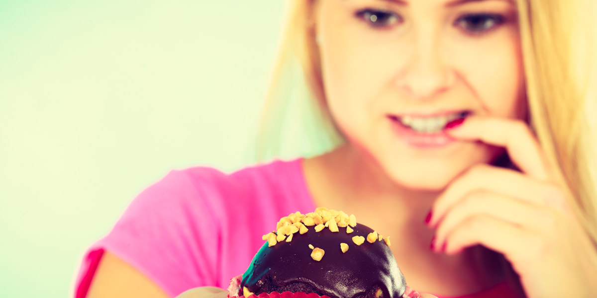 Woman desires chocolate cupcake