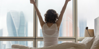 Young woman Stretching after a good sleep