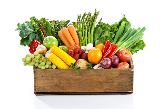 Leafy green vegetables with fruits