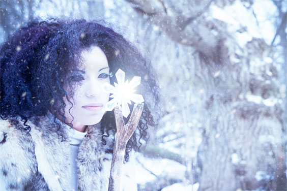 Snow Maiden With Crystal In A Winter Storm